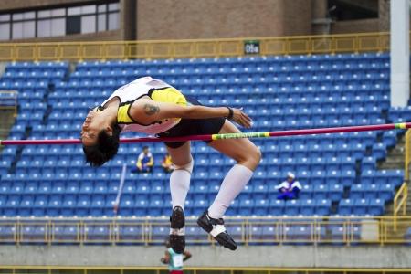 senior olympics: TAIPEI,TAIWAN -November 6,2012:woman high jump athlete in 17th Asia Master Athletics Championships in Taipei stadium on November 6,2012 in Taipei,Taiwan