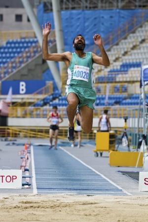 senior olympics: TAIPEI,TAIWAN -November 6,2012: man long jump athlete in 17th Asia Master Athletics Championships in Taipei stadium on November 6,2012 in Taipei,Taiwan