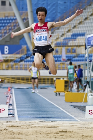 TAIPEI,TAIWAN -November 6,2012: man long jump athlete in 17th Asia Master Athletics Championships in Taipei stadium on November 6,2012 in Taipei,Taiwan Stock Photo - 16373297