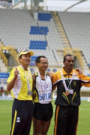 senior olympics: TAIPEI,TAIWAN -November 6,2012:athletes of medalists in 17th Asia Master Athletics Championships in Taipei stadium on November 6,2012 in Taipei,Taiwan