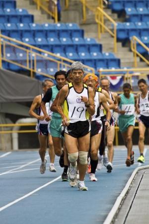 senior olympics: TAIPEI,TAIWAN -November 6,2012:10000m man race athlete in 17th Asia Master Athletics Championships in Taipei stadium on November 6,2012 in Taipei,Taiwan