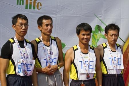 senior olympics: TAIPEI,TAIWAN -November 7,2012:athletes of medalists in 17th Asia Master  Athletics Championships in Taipei stadium on November 7,2012 in Taipei,Taiwan