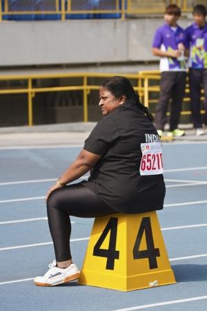senior olympics: TAIPEI,TAIWAN -November 7,2012:400m relay race woman athlete in 17th Asia Master  Athletics Championships in Taipei stadium on November 7,2012 in Taipei,Taiwan