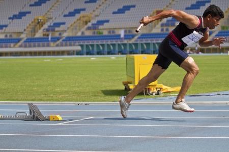 senior olympics: TAIPEI,TAIWAN -November 7,2012:400m man relay race athlete in 17th Asia Master  Athletics Championships in Taipei stadium on November 7,2012 in Taipei,Taiwan Editorial