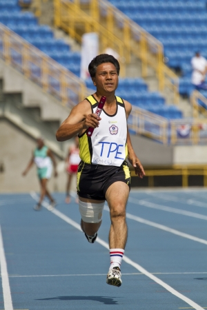 TAIPEI,TAIWAN -November 7,2012:400m man relay race athlete in 17th Asia Master  Athletics Championships in Taipei stadium on November 7,2012 in Taipei,Taiwan