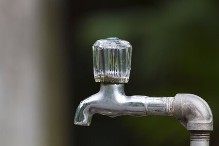 faucet with clear bokeh photo