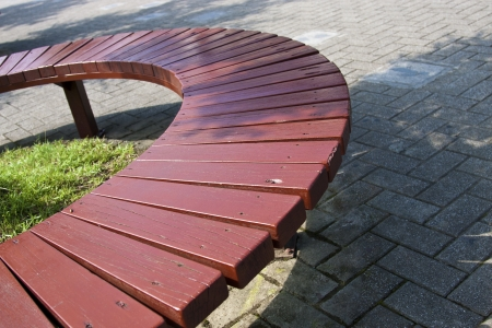 circle wooden bench in park photo