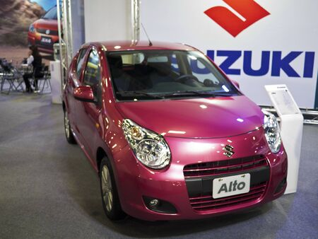 TAIPEI,TAIWAN -December 21 : new car of Suzuki Alto in 2013 New Car Exhibition in Taipei world trade center on December 21,2012 in Taipei,Taiwan Stock Photo - 17051421