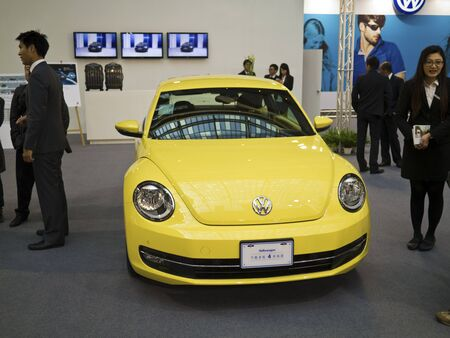 TAIPEI,TAIWAN -December 21 : yellow new car of volkswagen in 2013 New Car Exhibition in Taipei world trade center on December 21,2012 in Taipei,Taiwan Stock Photo - 17051436