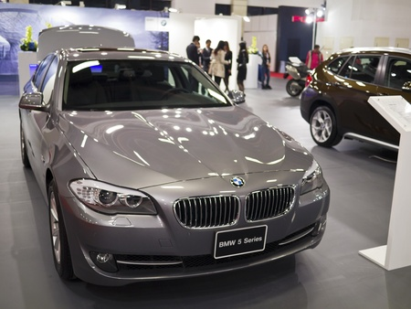 TAIPEI,TAIWAN -December 21 : new car of BMW 5 series in 2013 New Car Exhibition in Taipei world trade center on December 21,2012 in Taipei,Taiwan Stock Photo - 17051435