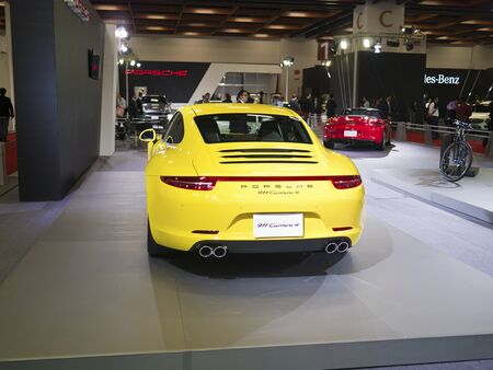 TAIPEI,TAIWAN -December 21 : yellow new car of porche 911 carrera 4 in 2013 New Car Exhibition in Taipei world trade center on December 21,2012 in Taipei,Taiwan Stock Photo - 17051431