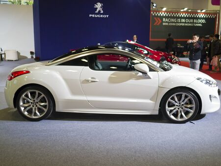 TAIPEI,TAIWAN -December 21 : new car of peugeot rcz in 2013 New Car Exhibition in Taipei world trade center on December 21,2012 in Taipei,Taiwan Stock Photo - 17051430