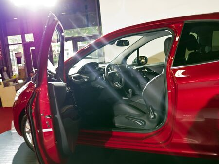 TAIPEI,TAIWAN -December 21 : red new car of peugeot 208 in 2013 New Car Exhibition in Taipei world trade center on December 21,2012 in Taipei,Taiwan Stock Photo - 17051427