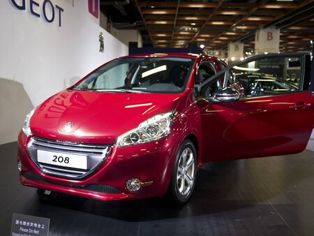TAIPEI,TAIWAN -December 21 : red new car of peugeot 208 in 2013 New Car Exhibition in Taipei world trade center on December 21,2012 in Taipei,Taiwan Stock Photo - 17051432