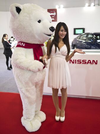 TAIPEI,TAIWAN -December 21 : nissan show girl in 2013 New Car Exhibition in Taipei world trade center on December 21,2012 in Taipei,Taiwan Stock Photo - 17051424