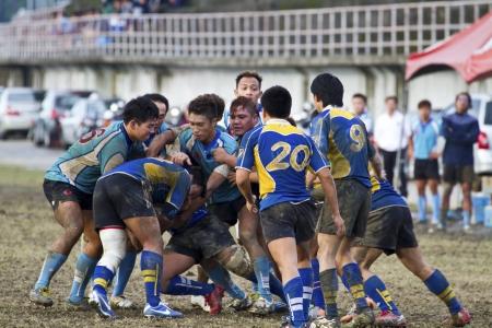 TAIPEI,TAIWAN - December 13 : unidentified rugby football players in the All-Taiwan rugby Football Competition in Taipei Bailing Rugby  Fields on December 13,2012 in Taipei,Taiwan Stock Photo - 17051506