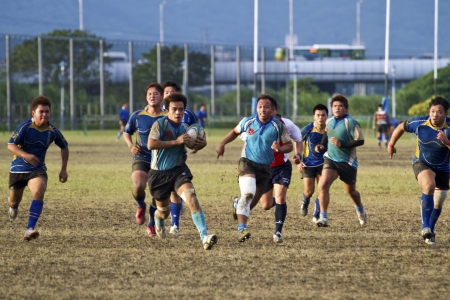 TAIPEI,TAIWAN - December 13 : unidentified rugby football players in the All-Taiwan rugby Football Competition in Taipei Bailing Rugby  Fields on December 13,2012 in Taipei,Taiwan Stock Photo - 17051547