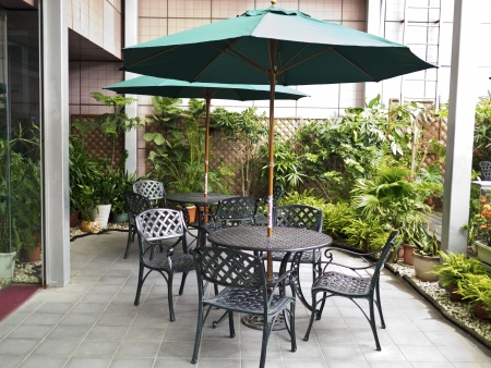 Coffee tables with umbrellas Stock Photo