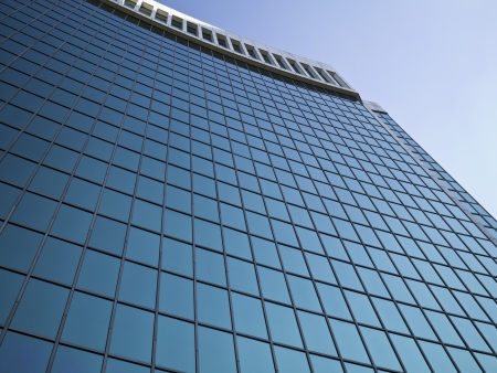 modern glass skyscraper exterior in city photo