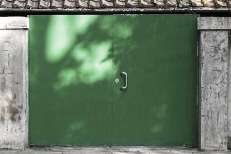 Closeup green metal door with lock in good texture. Stock Photo - 17633815