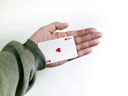 Poker player cheats with card from the sleeve  Challenge to the casino Stock Photo
