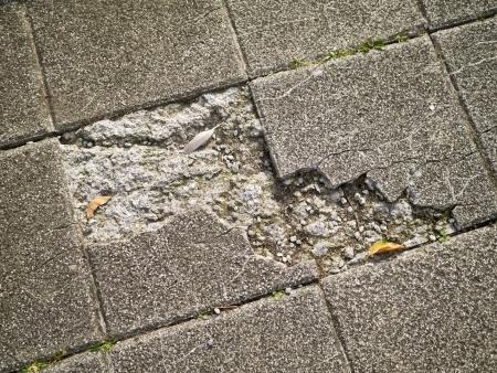 Old and broken asbestos floor tiles photo