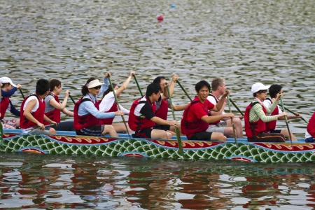 dragonboat: TAIPEI, TAIWAN-JUNE 9,2013:dragonboat teams racing during the 2013 Taipei Dragon Boat festival on JUNE 9,2013 in Taipei,Taiwan Editorial