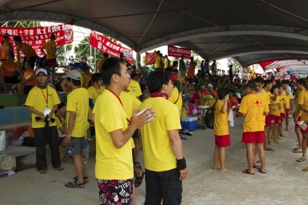 dragonboat: TAIPEI, TAIWAN-JUNE 9,2013:dragonboat teams players watching games in the 2013 Taipei Dragon Boat festival on JUNE 9,2013 in Taipei,Taiwan