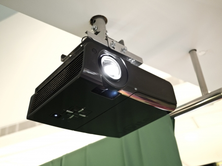 a black overhead projector on ceiling indoors photo