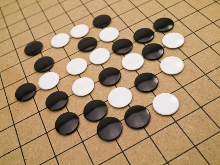 strategical: closeup view of stones on a Go board Stock Photo