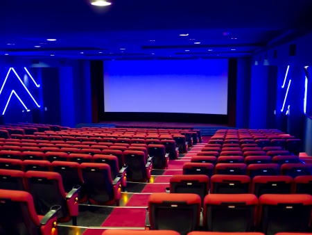 Empty cinema auditorium. Projection screen is ready for adding a picture Stockfoto