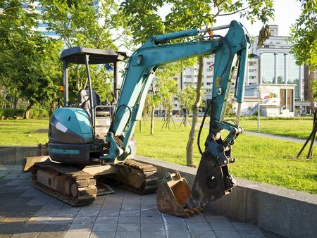 green excavator work in park Stock Photo - 21724464