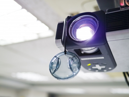 Video projector for work presentation or home cinema entertainment on ceiling photo