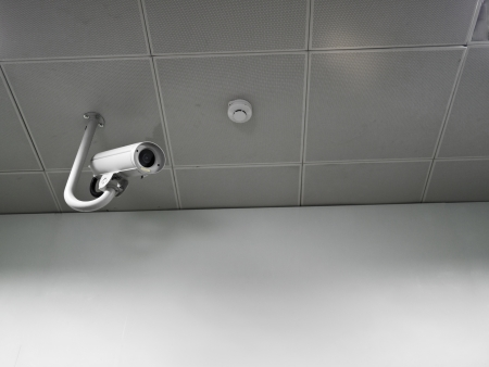 CCTV security camera on the ceiling photo