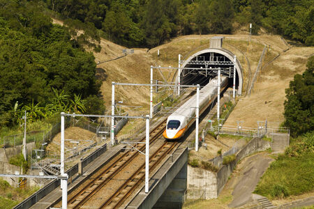 highspeed: high speed train driving across tunnel with mountain scenery