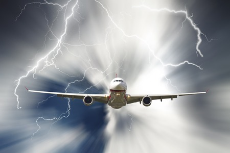 Passenger airplane travelling through sky against stormy bolt cloudscape photo