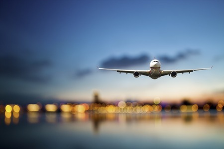transportation travel: perspective view of jet airliner in flight with bokeh background