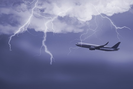 bolt: Passenger airplane travelling through sky against stormy bolt cloudscape