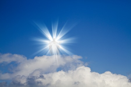 Jesus Christ in blue sky with white clouds