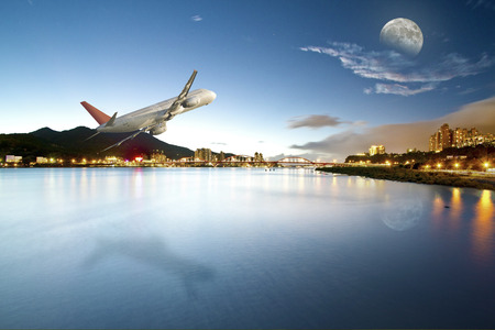 airliner: perspective view of airliner fly across river to moon