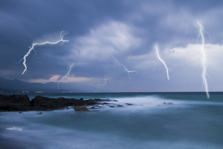 lightning bolt: Lightning flashes across the beach from a powerful storm