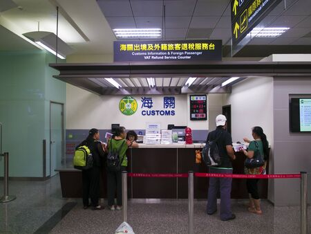 airport customs: Taipei, Taiwan - JUNE 27, 2015: Customs Information and Foreign Passenger VAT Refund Service Counter in Taipei Songshan Airport.