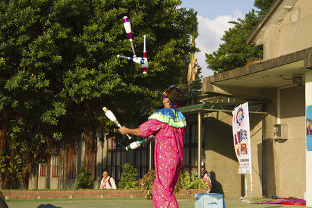 trapeze: New Taipei City, Taiwan - OCT 17, 2015: circus player performing in 435 Art Zone in Banqiao District. Editorial