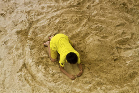 sandpit: Taipei, Taiwan - SEP 30, 2015: child playing in the sandpit in The Taipei Childrens Amusement Park