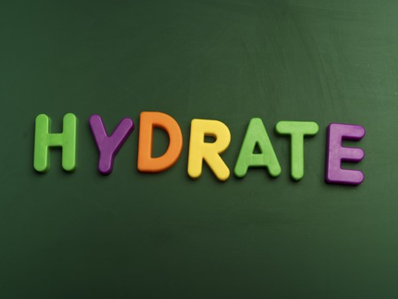 hydrate: hydrate concept in colorful letters isolated on blank blackboard