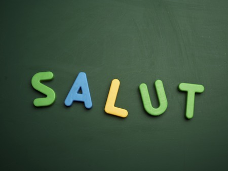 salut: salut concept in colorful letters isolated on blank blackboard