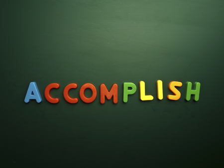accomplish: accomplish concept in colorful letters isolated on blank blackboard