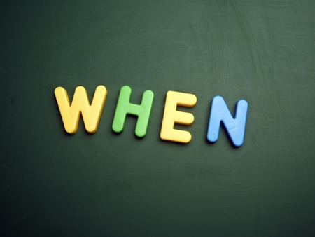 when: when concept in colorful letters isolated on blank blackboard Stock Photo