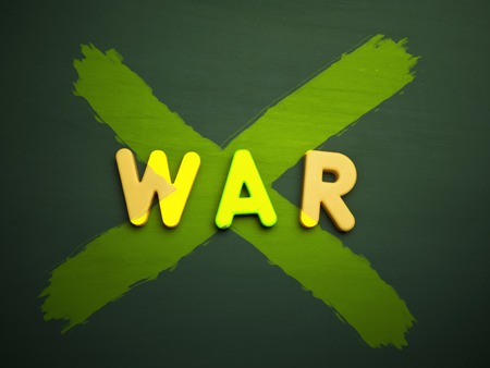 anti war: peace or anti war concept in colorful letters isolated on blank blackboard