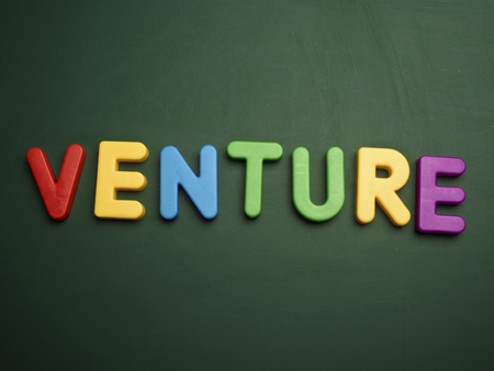 venture: venture concept in colorful letters isolated on blank blackboard